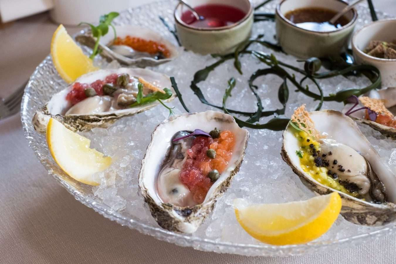 Tasty oysters on a plate.