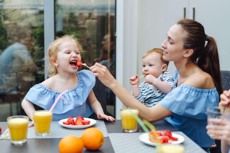 Happy family, fresh fruit breakfast in kitchen